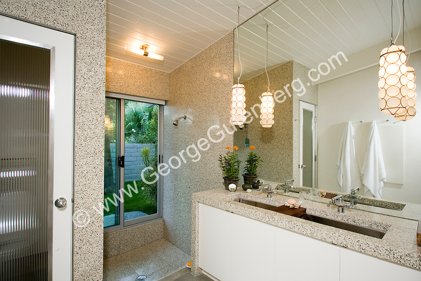 Custom double stainless sink shown in remodeled mid-century bathroom