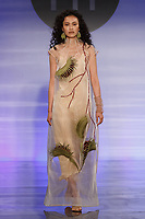 Model walks runway in an outfit by Candy Lowen, during the Future of Fashion 2017 runway show at the Fashion Institute of Technology on May 8, 2017.