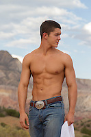 shirtless young man in jeans outdoors in New Mexico