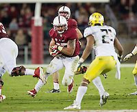 STANFORD, CA - November 7, 2013:  Stanford Cardinal running back Tyler Gaffney (25) takes the ball into the hole during the Stanford Cardinal vs the Oregon Ducks at Stanford Stadium in Stanford, CA. Final score Stanford Cardinal 26, Oregon Ducks  20.