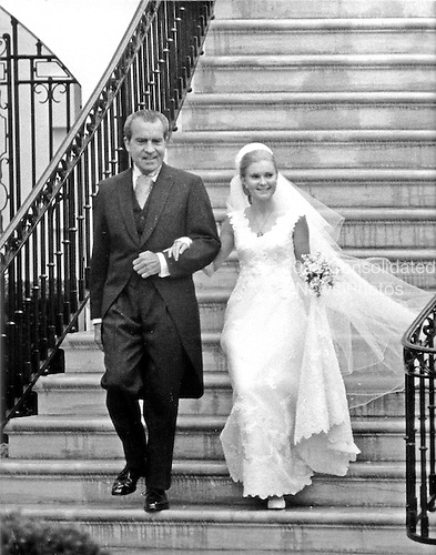 "Washington, DC - June 12, 1971 -- United States President Richard M. Nixon, left, and his daughter, Tricia, right, descend the steps of the South Portico of the White House in Washington, D.C. on Saturday, June 12, 1971 as Tricia was married to Edward Cox in a Rose Garden ceremony..Credit: Benjamin E. ""Gene"" Forte - CNP."