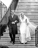 """Washington, DC - June 12, 1971 -- United States President Richard M. Nixon, left, and his daughter, Tricia, right, descend the steps of the South Portico of the White House in Washington, D.C. on Saturday, June 12, 1971 as Tricia was married to Edward Cox in a Rose Garden ceremony..Credit: Benjamin E. """"Gene"""" Forte - CNP."""