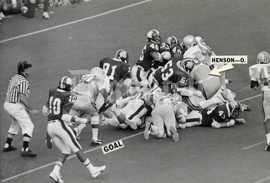 OSU-MICHIGAN STATE GAME November 9, 1974. Officials ruled that Ohio State fullback Champ Henson (38) failed to break the plane of the goal line on this plunge over right tackle in the final seconds of Saturday's game at Michigan State. Time ran out before another play, giving Michigan State a 16-13 upset victory. (Columbus Dispatch photo)