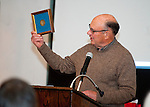 WOODBURY,  CT-122716JS09-- Mac Warner, son of 1932 Olympic gold medalist Karl Warner, holds up his fathers gold medal during the third annual Nonnewaug Athletic Club's Woodbury-Bethlehem Hall of Fame ceremony held Tuesday at the Old Town Hall in Woodbury. Being inducted this year were Karl Warner (1928), winner of the gold medal in the 4x1600 really in the 1932 Olympics; Martha Newell (1965), Richard Archambault (1966) and Kelly McOmber (2000). <br /> Jim Shannon Republican-American