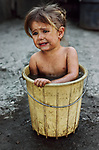00292_17, PARAGUAY-10006; NYC9466, MCS1985005 K100, Portraits_Book, Filadelfia, Paraguay, 1986, A young mennonite farm girl takes a bath in a bucket at home