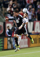 DC United midfielder Santino Quaranta (25) and LA Galaxy defender Sean Franklin (28) battle for the ball during the first half of the game between LA Galaxy and the D.C. United at the Home Depot Center in Carson, CA, on September 18, 2010. LA Galaxy 2, D.C. United 1.