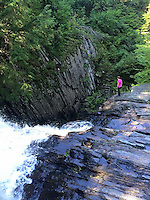 Courtesy photo/KRISTEN LEWIS<br /> Lewis checks out a waterfall along the Appalachian Trail.