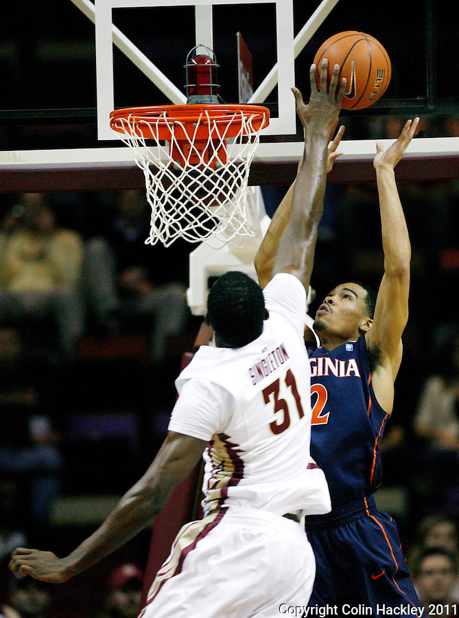 TALLAHASSEE, FL 10-FSU-VA MBB11 CH-Florida State's Chris Singleton battles Virginia's Mustapha Farrakhan for a rebound during first half action Saturday at the Donald L. Tucker Center in Tallahassee...COLIN HACKLEY PHOTO