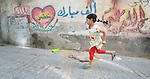 A girl plays hopscotch in the Al-Shalti refugee camp in Gaza. Residents of the Palestinian territory are still reeling from the death and destruction of the 2014 war with Israel, and the continuing siege of the seaside territory by the Israeli military.