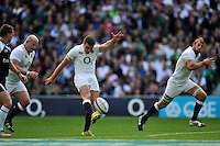 George Ford of England restarts play. QBE International match between England and Ireland on September 5, 2015 at Twickenham Stadium in London, England. Photo by: Patrick Khachfe / Onside Images