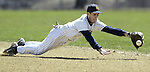 Pine Bush second baseman John Burrow dives for a ground ball during a game against Cornwall in Pine Bush on Monday, April 13, 2009.