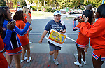 Participants are cheered by cheerleaders from a local high school as they finish the CROP Hunger Walk in Raleigh, North Carolina, on October 27, 2013.