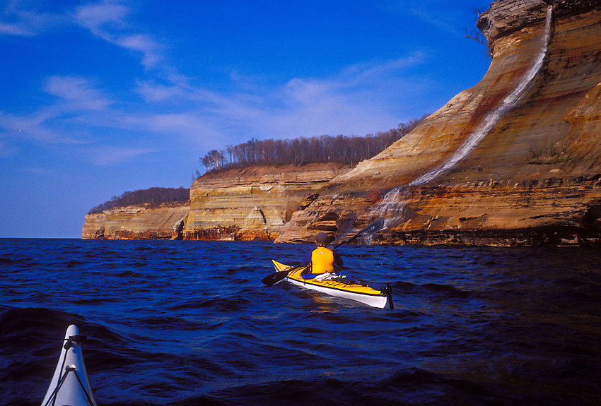 Sea kayakers paddle past Bridal Veil falls as it spills into Lake Superior in Pictured Rocks National Lakeshore near Munising, Mich.