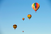 Hot air balloons float in the North Carolina sky during the 2012 Carolina Balloon Festival, held each October at the Statesville Regional Airport north of Charlotte. The annual festival is part of a fundraiser for the National Balloon Rally Charities, a 501(c)(3) charitable organization.