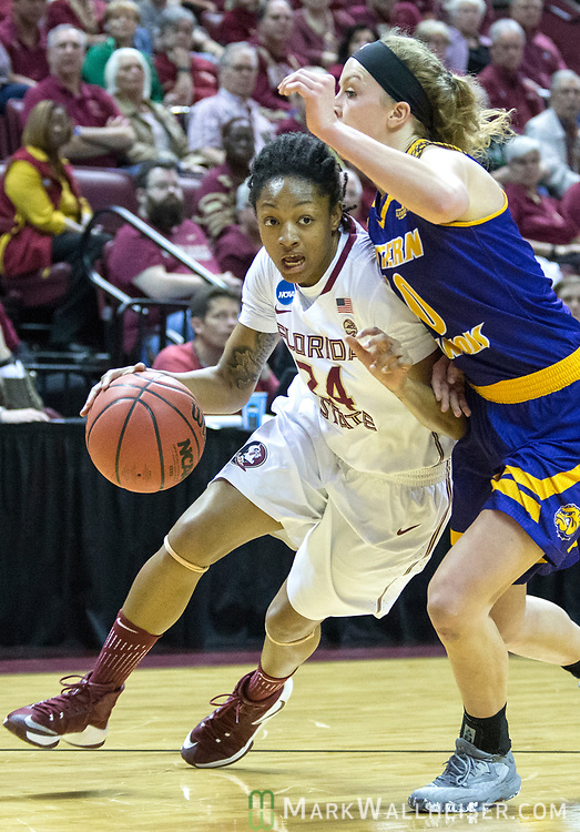 Florida State guard Nicole Ekhomu tries to get under Western Illinois guard Mallory Boyle on her way to the basket during the second half of a first-round game of the NCAA women's college basketball tournament in Tallahassee, Fla., Friday, March 17, 2017. Florida State defeated Westeren Illinois 87-66. (AP Photo/Mark Wallheiser)