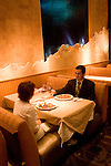 A couple in a restaurant in Las Vegas Nevada, NV, Las Vegas, city, food, drink, wine, couple, man, woman, restaurant, model released, Wolfgang Puck's Spago Cafe in the Forum Shopping Mall of Caesars Palace Hotel and Casino,  property released, Chef's special Salmon Pizza with capers, Cuban Sandwich, Photo nv268-17124..Copyright: Lee Foster, www.fostertravel.com, 510-549-2202,lee@fostertravel.com
