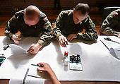 The last draft.Polish army officers interviewing a young soldier-to-be, before he enters the military zone in Bartoszyce, northern Poland.May 2008.<br /> Photo by Piotr Malecki / Napo Images).<br /> <br /> Ostatni pobor.Wcielenie do jednostki w Bartoszycach, rozmowa z przelozonym, przed otrzymaniem munduru. 5/2008.<br /> Fot: Piotr Malecki / Napo Images