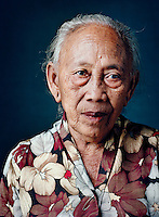 "Semi (born 1931) was one of tens of thousands of 'comfort women' forced into prostitution by the Japanese military during World War II..As a 13-year-old girl, Semi was for three months picked up from home almost daily and forced into prostitution at different locations, often nearby hotels. She was constantly picked up with a group of girls from the village, among them an older, already married sister. ""My parents said: 'It doesn't matter, just go with them.' Refusal was impossible. They took us, and then we had to wash up, put on a kimono and do our make-up with lipstick and powder. After that, I had to massage the soldiers and cuddle with them, let them kiss me, and such. For an hour, then it was the next one's turn, until the whistle blew. That was the sign for us to gather at the truck to go home. And the next day they came to get us again."" After the war she heard that a second sister, Wagiyem (also portrayed in this series) had been kept for months in a barracks and systematically raped."