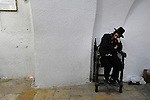 An Ultra-Orthodox Jewish man sleeps at Samuel's Tomb (Nabi Samuel) on the outskirts of Jerusalem. Jewish worshippers visited and prayed at the tomb of the biblical Hebrew prophet Samuel, marking the anniversary of his death.