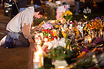 tucsonshooting - 09 JANUARY 2011 - TUCSON, AZ: Estevan Martinez (CQ) prays at a memorial for Gabrielle Giffords at University Medical Center in Tucson Sunday night. Congresswoman Gabrielle Giffords, US Federal Judge John Roll and several other people were shot by a lone gunman in a mass shooting Saturday.     ARIZONA REPUBLIC PHOTO BY JACK KURTZ