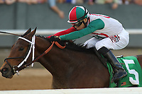 HOT SPRINGS, AR - APRIL 15: Inside Straight #5, with jockey Geovanni Franco aboard before crossing the finish line in the Oaklawn Handicap at Oaklawn Park on April 15, 2017 in Hot Springs, Arkansas. (Photo by Justin Manning/Eclipse Sportswire/Getty Images)