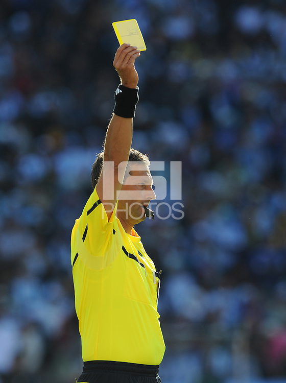Belgium referee Frank De Bleeckere issues a yellow card. Argentina defeated South Korea, 4-1, in both teams' second match of play in Group B of the 2010 FIFA World Cup. The match was played at Soccer City in Johannesburg, South Africa June 17th.