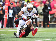 College Park, MD - OCT 1, 2016: Purdue Boilermakers running back Markell Jones (8) is tackled for a loss by Maryland Terrapins defensive lineman Cavon Walker (18) during game between Maryland and Purdue at Capital One Field at Maryland Stadium in College Park, MD. The Terps got the win 50-7 over visiting Purdue. (Photo by Phil Peters/Media Images International)