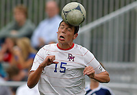 HYATTSVILLE, MD - OCTOBER 26, 2012:  Austin Reed (15) of DeMatha Catholic High School heads the ball against of St. Albans during a match at Heurich Field in Hyattsville, MD. on October 26. DeMatha won 2-0.