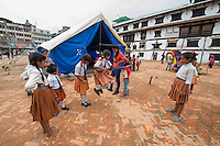 Nepal, Kathmandu, earthquake damage at Kathmandu Durbar Square. Temporary school.