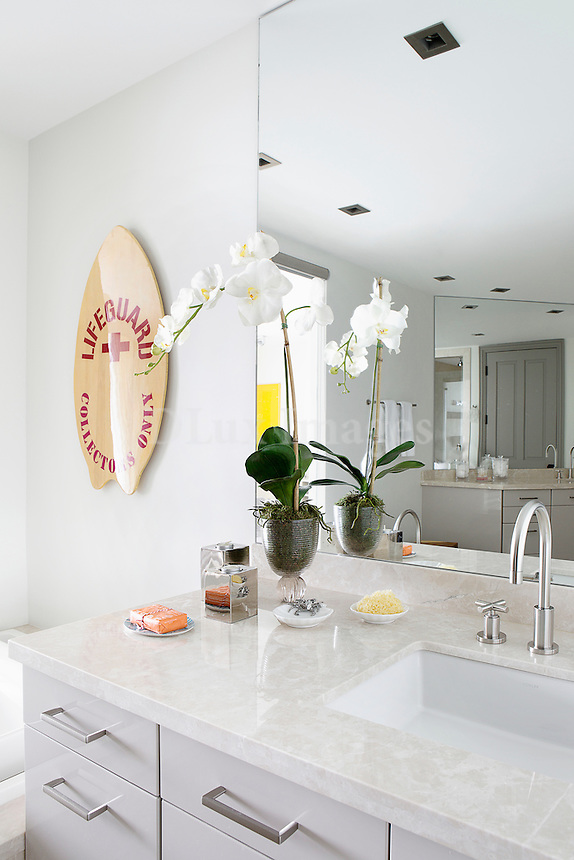 Bright modern bathroom with white worktop and cabinets