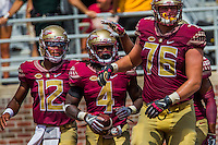 TALLAHASSEE, FLA 9/10/16-Florida State's Deondre Francois, left, celebrates Dalvin Cook's touchdown with Travis Rudolph (obscured) and Rick Leonard during second quarter action against Charleston Southern, Saturday at Doak Campbell Stadium in Tallahassee. <br /> COLIN HACKLEY PHOTO