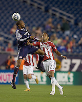 New England Revolution defender Cory Gibbs (12) heads the ball. Chivas USA defeated the New England Revolution, 4-0, at Gillette Stadium on May 5, 2010.