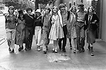 Old scholars going to the Eton Harrow annual cricket match at Lords. St Johns Wood, north London. England. 1975. Sisters brothers girl and boy friends