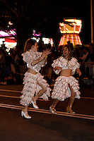 Two young girls in costume dancing in Canrnival Street procession at Carnival of Santa Cruz de Tenerife, Canary Islands, Spain