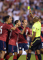 Michael Orozco Fiscal (5), Juan Agudelo (18), Edgar Castillo (2) and Landon Donovan (10) of the USMNT argue for a red card with referee Raymond Bogle during the game at Lincoln Financial Field in Philadelphia, PA. The USMNT tied Mexico, 1-1.
