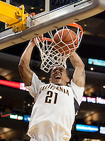Omondi Amoke dunks the ball. The California Golden Bears defeated the Oregon Duck 90-74 during the Pacific Life Pac-10 Conference Tournament at Staples Center in Los Angeles, California on March 11th, 2010. The Bears will face UCLA tomorrow at 6pm PST.