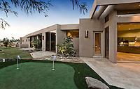 Private putting green of large home