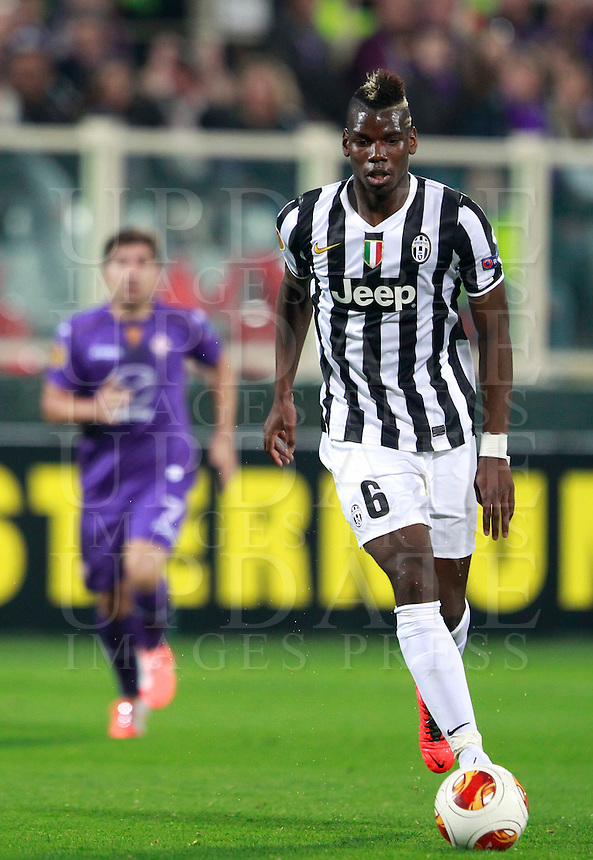 Calcio, ritorno degli ottavi di finale di Europa League: Fiorentina vs Juventus. Firenze, stadio Artemio Franchi, 20 marzo 2014. <br /> Juventus midfielder Paul Pogba, of France, in action during the Europa League round of 16 second leg football match between Fiorentina and Juventus at Florence's Artemio Franchi stadium, 20 March 2014. Juventus won 1-0 to advance to the round of eight.<br /> UPDATE IMAGES PRESS/Isabella Bonotto