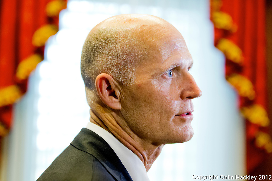 TALLAHASSEE, FLA. 8/7/12-Gov. Rick Scott talks with the media after the cabinet meeting August 7, 2012 in his office at the Capitol in Tallahassee..COLIN HACKLEY PHOTO
