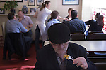 Senior man, Oap eating lunch. Chips. Regency Café  Westminster London SW1 UK.