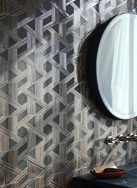 Hector, a stone waterjet mosaic, shown in Bayard polished and Burnt Umber glass honed, is part of the Altimetry Collection for New Ravenna.