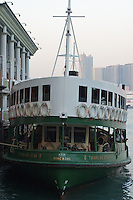 "The Star Ferry Company's ""Twinkling Star"" (built 1964) docked at the terminal in Central, Hong Kong"
