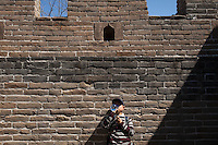 A boy at the restored part of Mutianyu Great Wall.