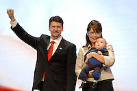 St. PAUL, MN - September 3, 2008: Sarah Palin with her son Trig Palin, who has down syndrome and her husband Todd Palin onstage at the 2008 Republican National Convention at the Excel Center in St. Paul, Minnesota.