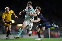 Simon Davies of Cambridge University is tackled by Tom Stileman of Oxford University. The Varsity Match between Oxford University and Cambridge University on December 10, 2015 at Twickenham Stadium in London, England. Photo by: Patrick Khachfe / Onside Images