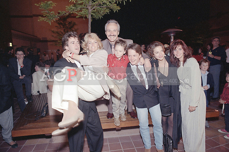 "May 01, 1989 - Los Angeles, California, USA - Cast members of NBC's ""Family Ties,"" from left: Scott Valentine, Meredith Baxter Birney, Michael Gross, Brian Bonsall, Michael J. Fox, Justine Bateman and Courteney Cox, celebrate their seventh and final season, May 1, 1989, during a wrap party at the Gene Autry Western Heritage Museum in Los Angeles..(Credit Image: © Alan Greth)"