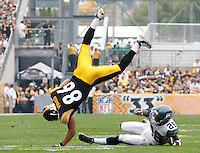 PITTSBURGH - SEPTEMBER 18:  Hines Ward #86 of the Pittsburgh Steelers is flipped over Walter Thurmond #28 of the Seattle Seahawks after catching a pass in the first half during the game on September 18, 2011 at Heinz Field in Pittsburgh, Pennsylvania.  (Photo by Jared Wickerham/Getty Images)