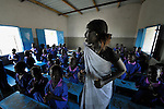 Students sing a song in a Catholic school in Malakal, Southern Sudan. Encouraging them is their teacher, Regina John Thabo, who is studying to be a better teacher in a program sponsored by Solidarity with Southern Sudan, an international network of Catholic groups supporting Southern Sudan with educational personnel and prayer. NOTE: In July 2011 Southern Sudan became the independent country of South Sudan.
