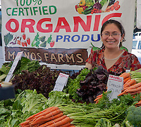 Isabelle with her organic produce from Menos Farms at South Coast Collection's Farmers' Market.  SR.