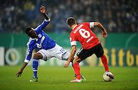 FUSSBALL   DFB POKAL    SAISON 2012/2013    ACHTELFINALE FC Schalke 04 - FSV Mainz 05                          18.12.2012 Chinedu Obasi (li, FC Schalke 04) gegen Marco Caligiuri (re, FSV Mainz 05)